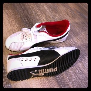 Woman's sporty looking Puma Tennis Shoes size 5